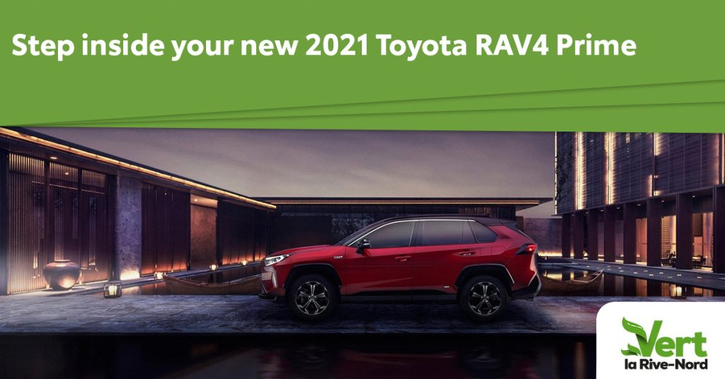 A red RAV4 Prime in a house parking lot