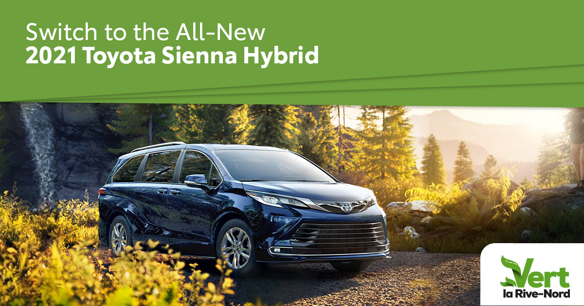 a blue 2021 Sienna hybrid in the forest
